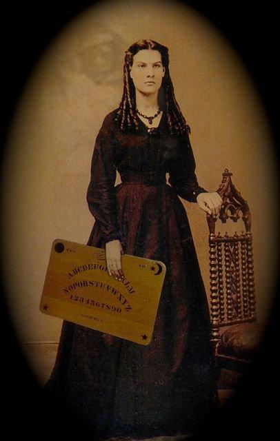 woman wtth board1 - Cadı Tahtası Ouija